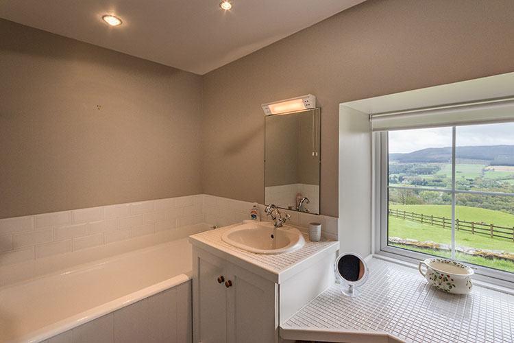Aodin bathroom with bath