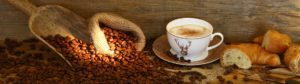 Coffee beans, cup of coffee and pastries