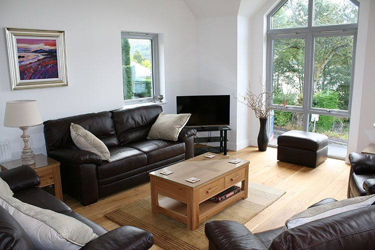 Craigard living area with flat screen TV