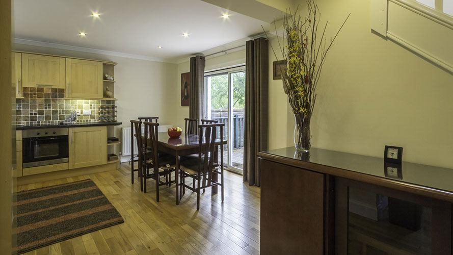 River View Cottage open plan kitchen and dining area which opens onto decking