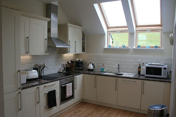 Open plan kitchen area of luxury 4 star self catering house over looking Loch Tay Highland Perthshire