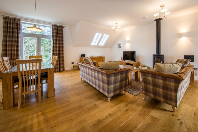 Living area and wood burning stove in Saorsa a luxury self catering cottage in Kenmore Loch Tay