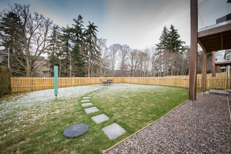 Rear garden with dining furniture and BBQ
