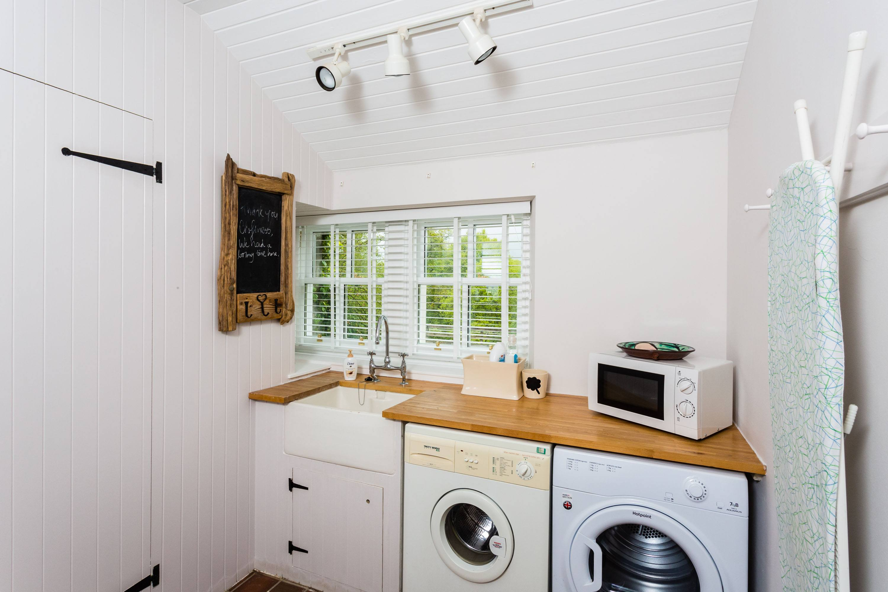 Croftness Cottage utility room with washing machine and tumble dryer