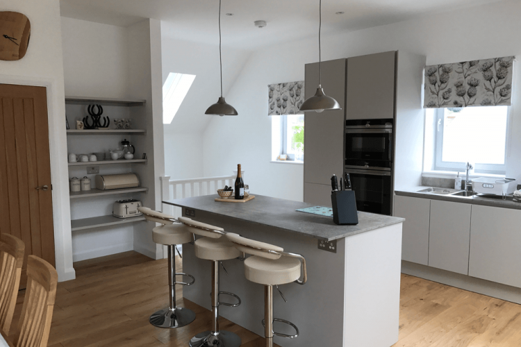 Modern and well equipped kitchen with breakfast bar in the luxury self catering house Saorsa