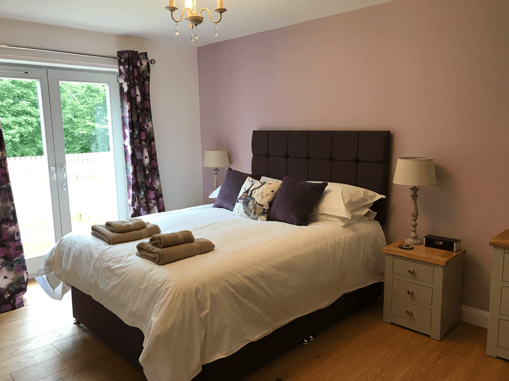 Saorsa master bedroom with patio doors to private garden in 4 star self catering house Saorsa