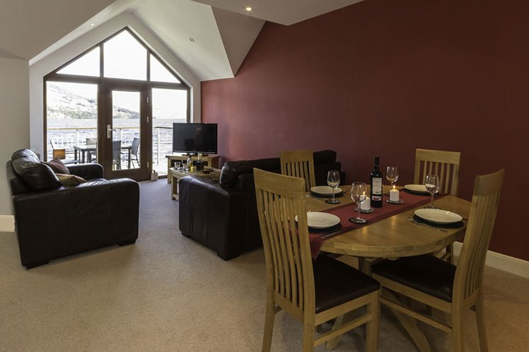 Ben Lawers open plan living and dining area with views over Loch Tay