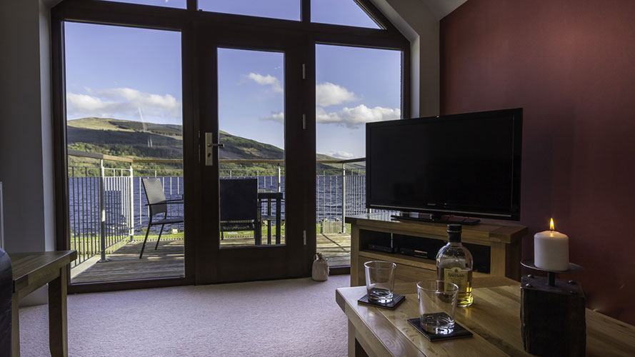 Ben Lawers living room with balcony overlooking Loch Tay