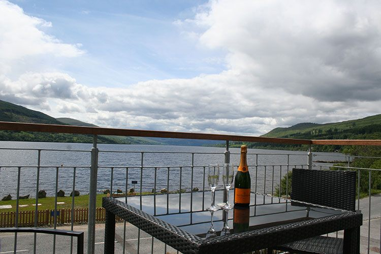 Ben Lawers balcony with table and chairs and views over Loch Tay