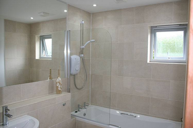 Craigard bathroom with shower over bath