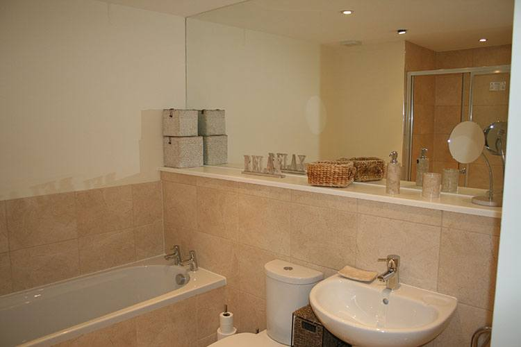 Family bathroom with seperate shower cubicle