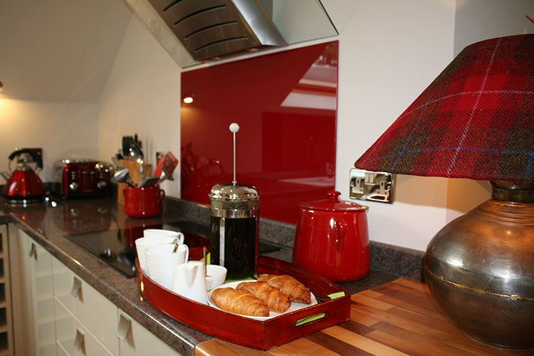 The Wee Cosy Nook kitchen with red accents