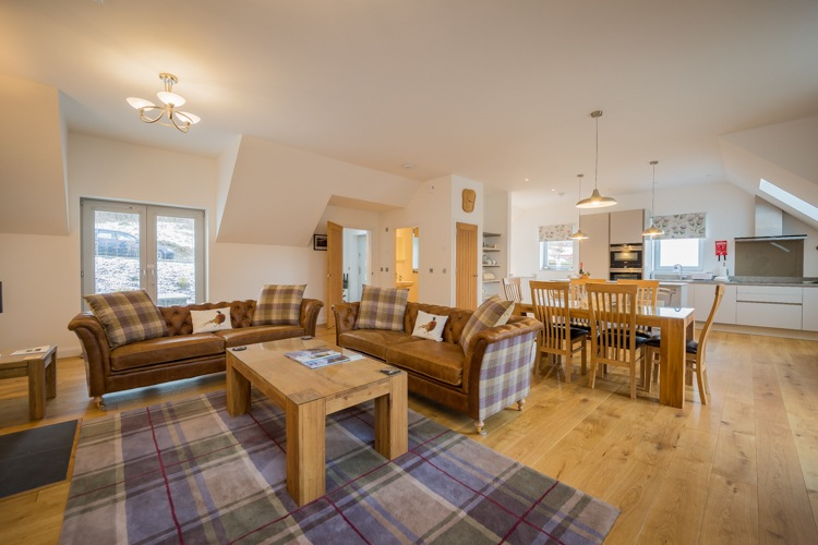 Saorsa open plan kitchen, dining and living area with stunning views of Loch Tay and Kenmore village