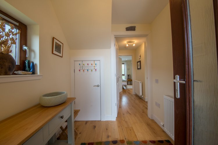 Tarmachan entrance vestibule leading to hallway and downstairs bedrooms