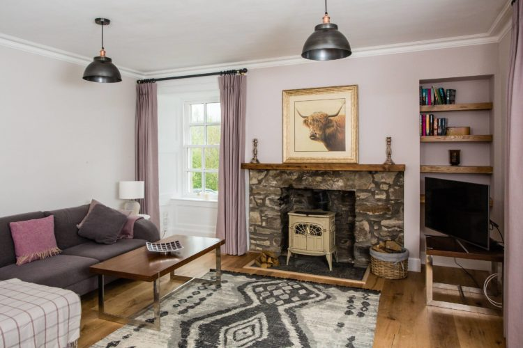 Croftness Cottage living area with wood burning stove
