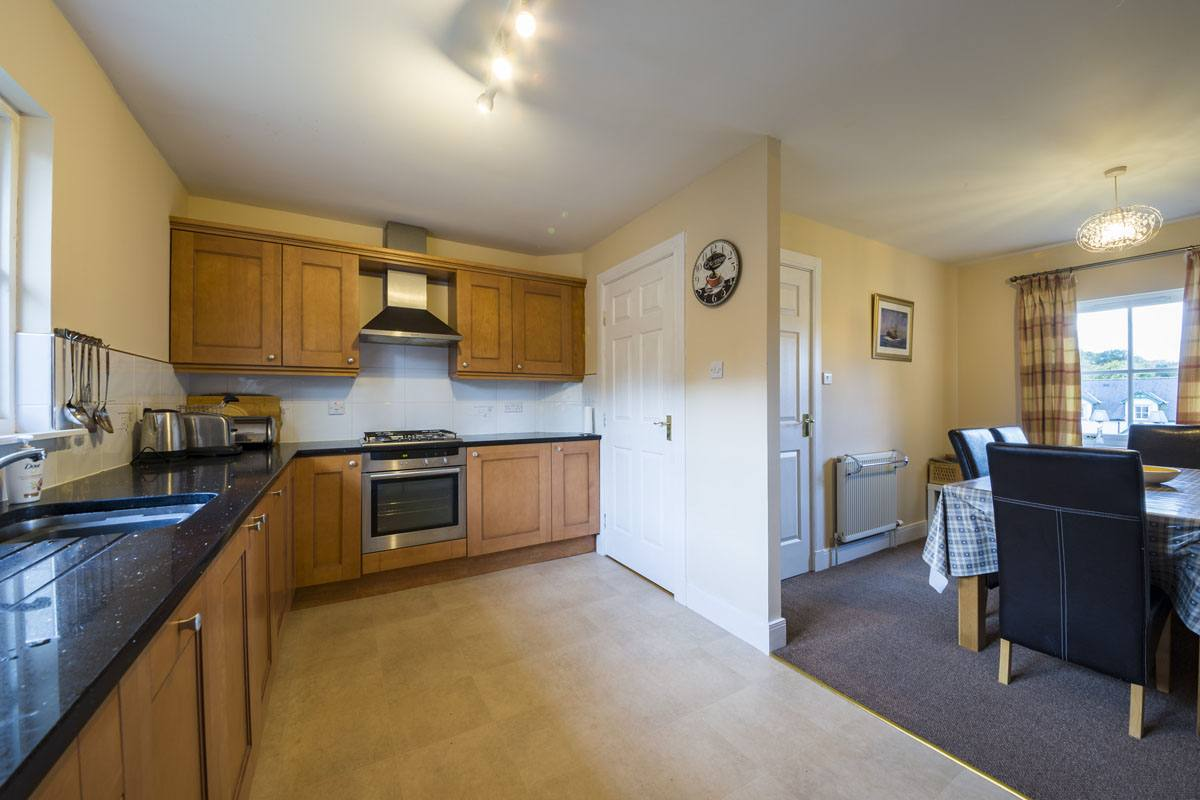 Fraoch Cottage has a well equipped kitchen with dining area