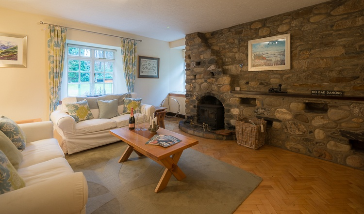 Cosy sitting room with wood burner