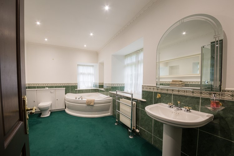 Master En-suite bathroom with large corner bath