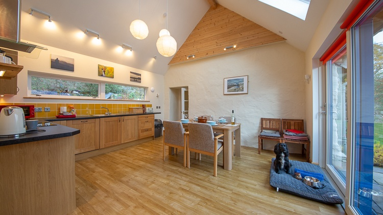 Bright and spacious dining kitchen with large patio doors and plenty of room for the dog!  Dog bed, towels, bowl, treats and poo bags provided.