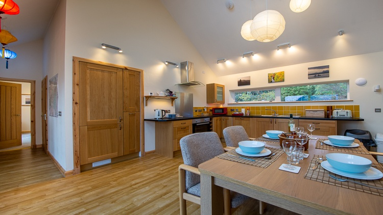 Bright and spacious kitchen with views of the garden and hills beyond. Well equipped kitchen. Separate utility room.