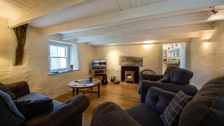 Cosy sitting room with log burner and flat screen TV