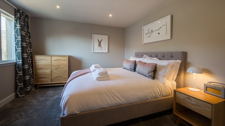 Master bedroom with king size bed, views of Loch Tay and en-suite bathroom