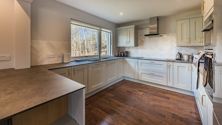 Beautiful, well equipped kitchen with views of the woodland garden