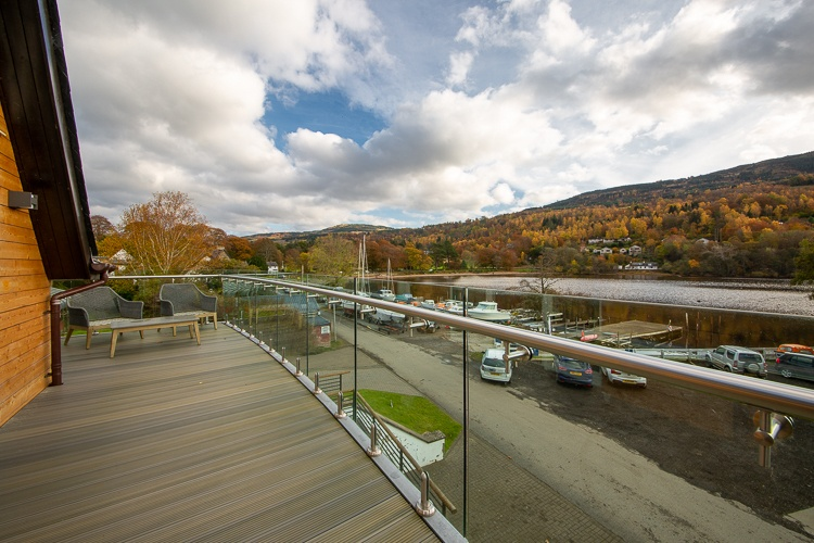 Large balcony with glass balustrade to make the most of the stunning views of Loch Tay
