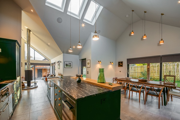 Beautiful dining area with large sliding doors leading out to alfresco dining space
