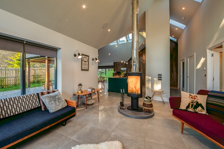 Open plan living space with wood burner, large flat screen TV, Sky and sound system