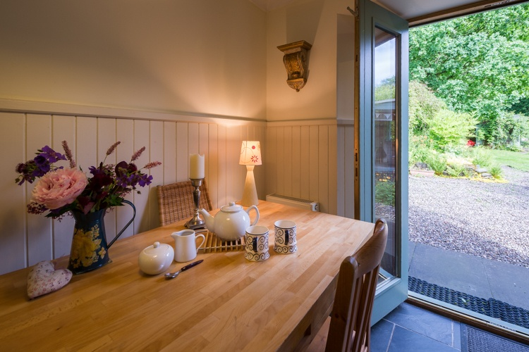Large dining table in the kitchen, looking out to the garden.