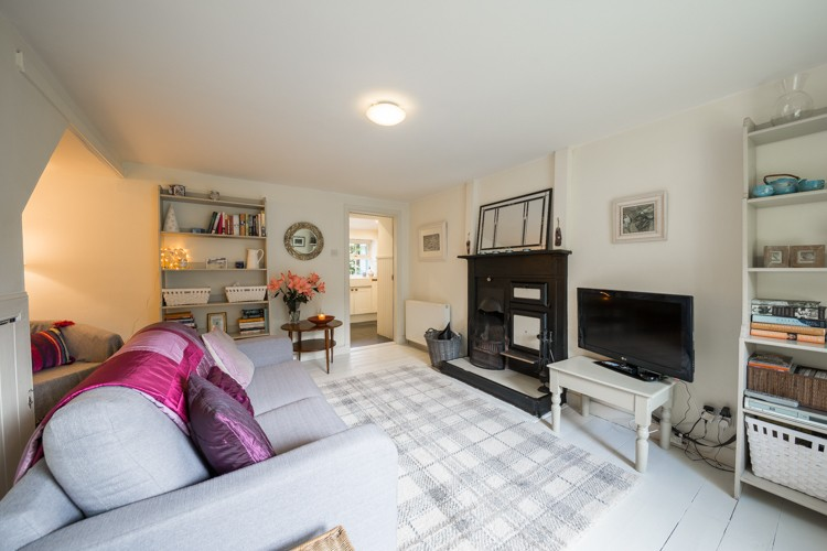 Family room with open fire and TV with BT Vision