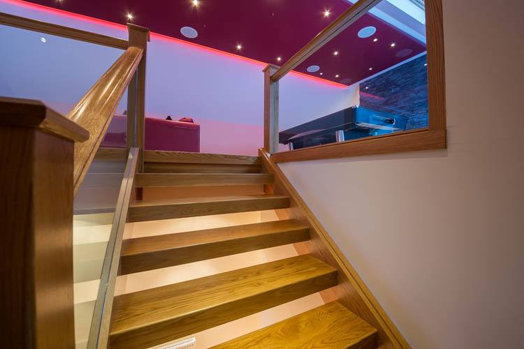 Stairs leading to upper level with Cinema Room and Master Bedroom