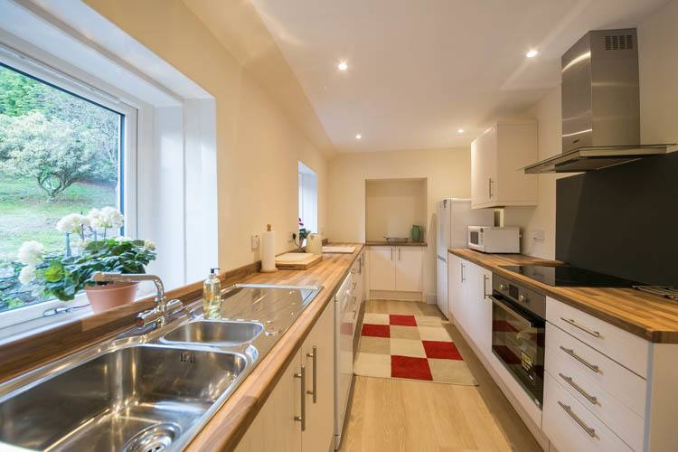 Well equipped, modern kitchen overlooking the garden