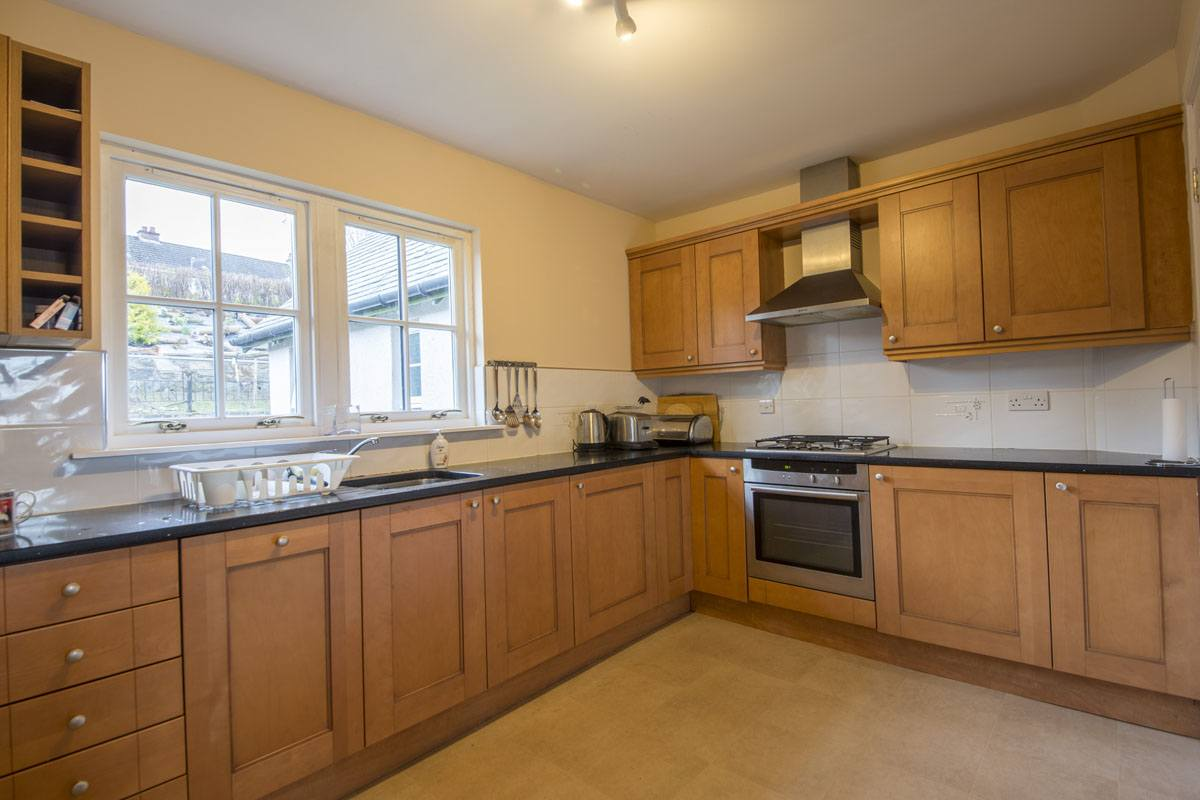 Fraoch Cottage has a spacious kitchen looking out onto rear garden