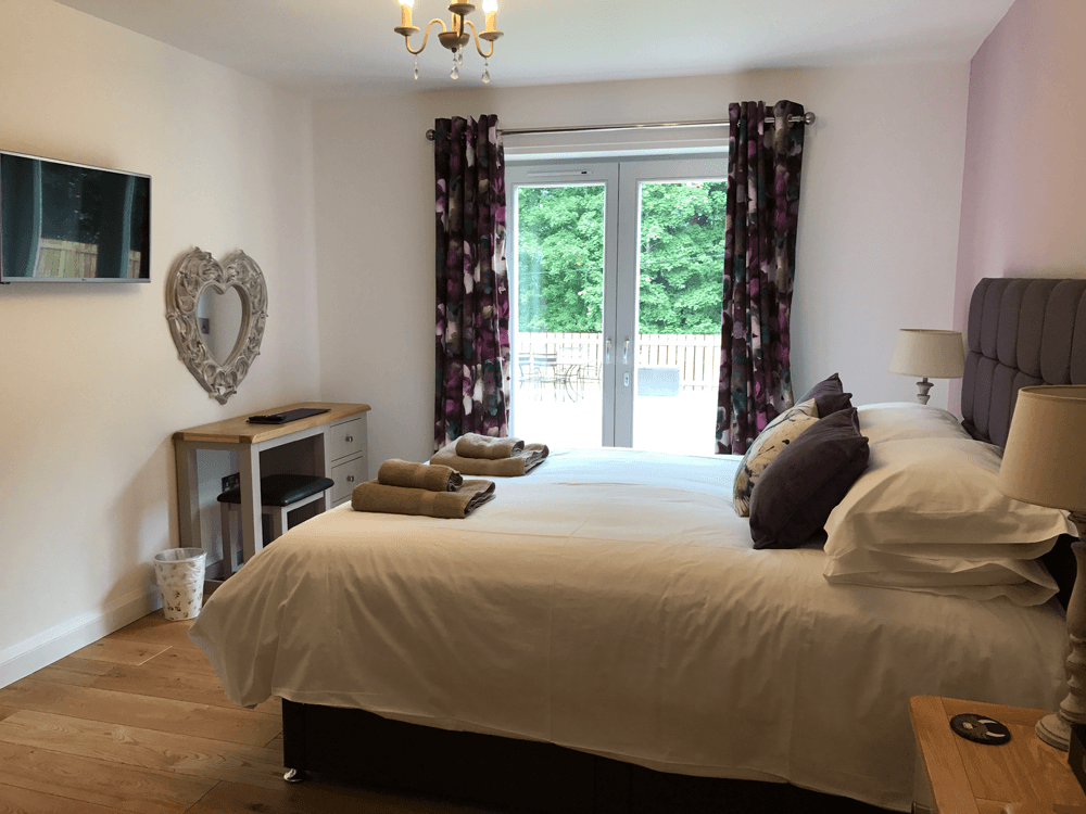 Saorsa master bedroom with french doors