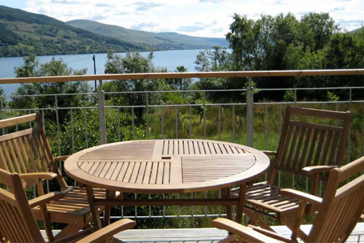 Tarmachan balcony with table and chairs and views over Loch Tay